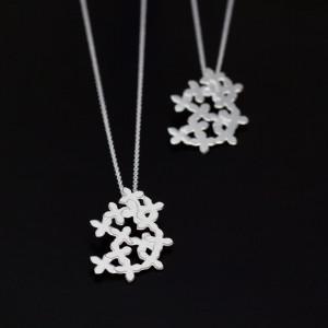 Morotsblommor av silver. Petronella 750kr